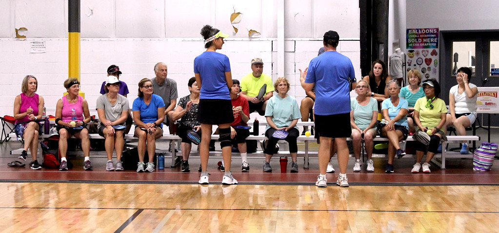 . Pickleball instructors speak to a group at The Mill Works in Westford before having them hit the courts for a clinic. SUN/David H. Brow