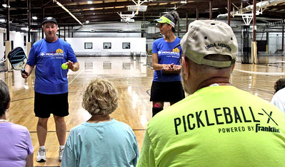 Speaking at a clinic on Pickleball are instructors L-R, Paul Lambers and Beverly Russo, at The Mill Works in Westford. SUN/David H. Brow