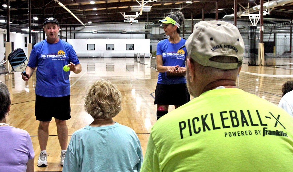 . Speaking at a clinic on Pickleball are instructors L-R, Paul Lambers and Beverly Russo, at The Mill Works in Westford. SUN/David H. Brow