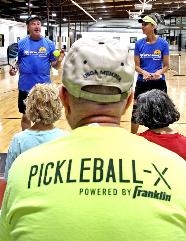 . Instructors Paul Lambers and Beverly Russo conduct a clinic on how to play Pickleball at The Mill Works in Westford. SUN/David H. Brow