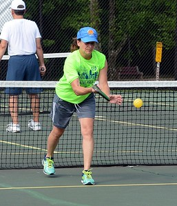 Pickleball player demonstrates proper serve.