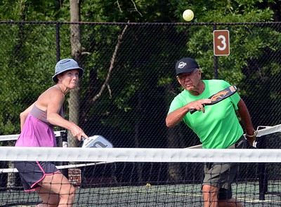 Sue Robus, left, and teammates follow flight of the ball at Masons Mill Park.