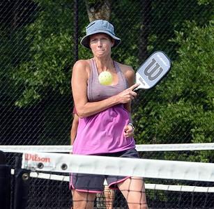 Sue Robus follows through on forehand shot.