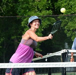 Sue Robus follows through on slam shot.