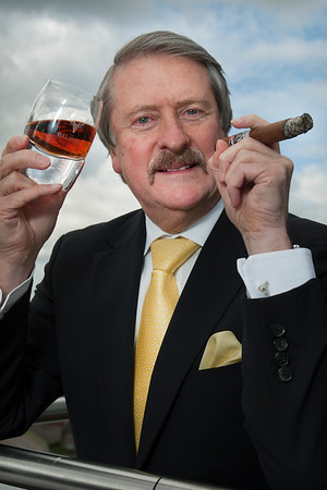 Whyte and Mackay master blender -Richard Paterson with The Dalmore Cigar Malt and matching cigar.
