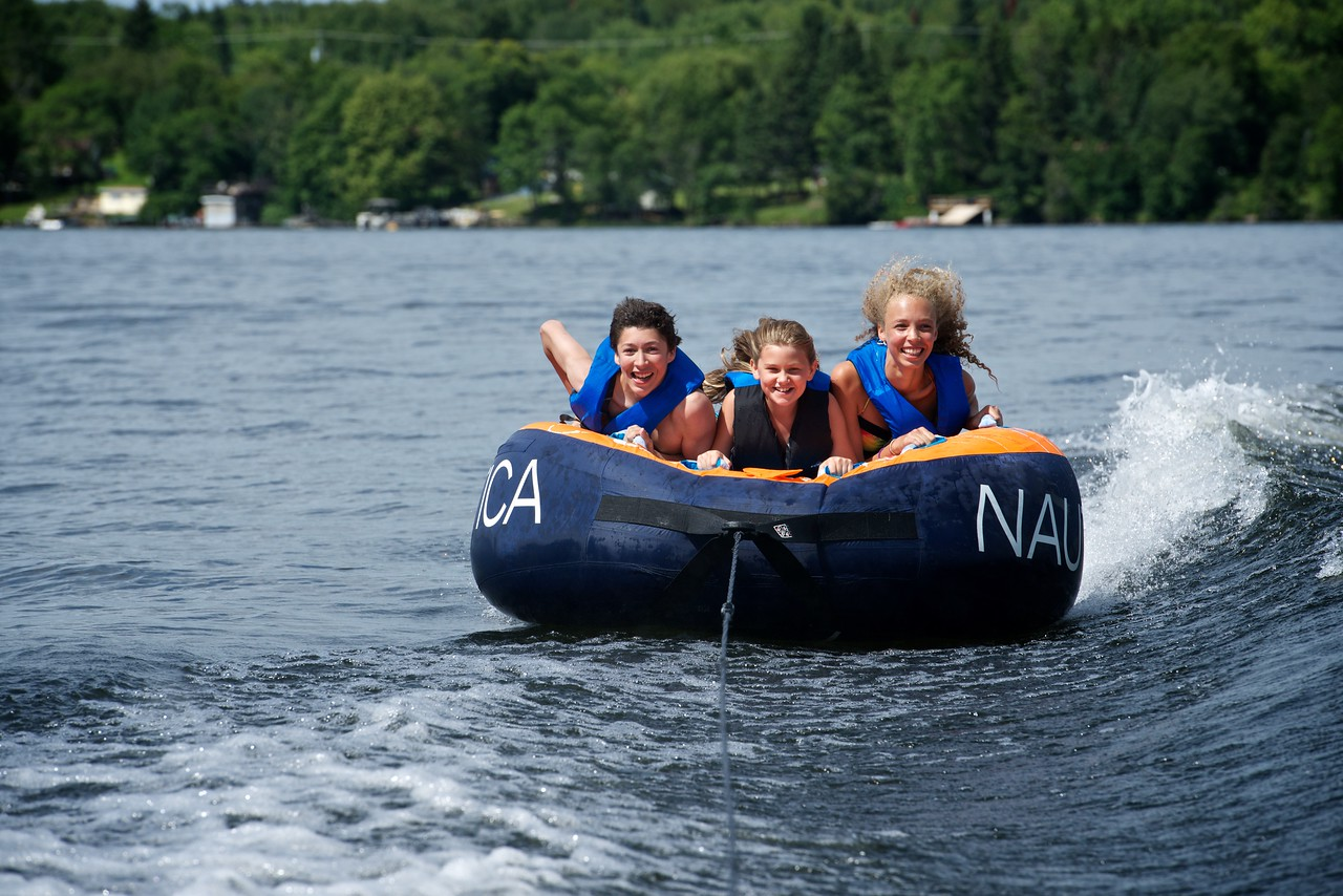 All smiles riding the tube, Cottage, Lac Lu