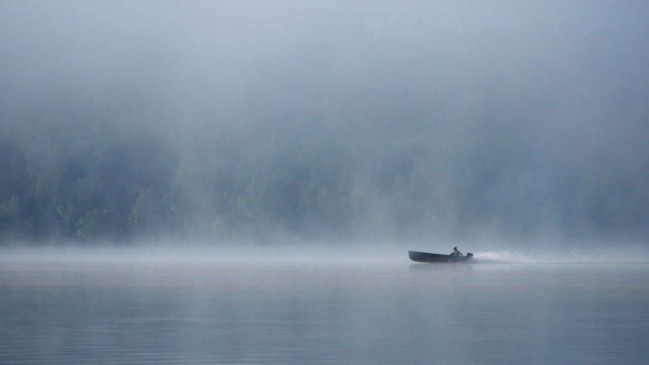 Early morning boat ride in the mist