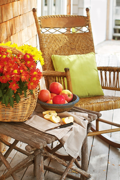 Rustic porch with apples and rocking chair