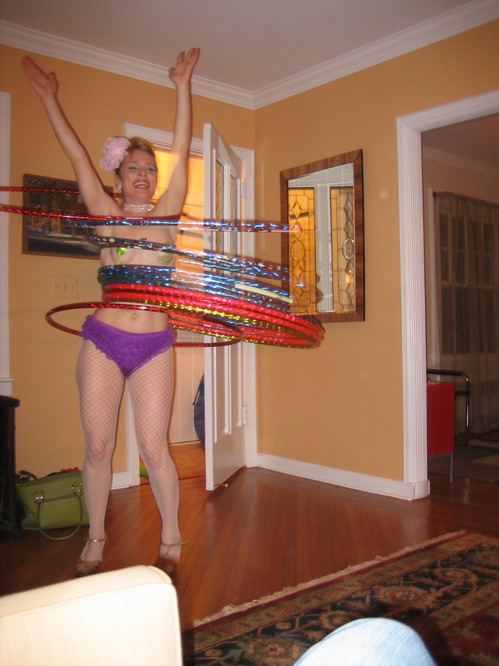 """APRIL 8, 2006<br /> <br /> Miss Saturn performs her magic at Chris Martin's birthday bash.  See all of the fun in the gallery called """"Miss Saturn"""".  It was quite a night."""