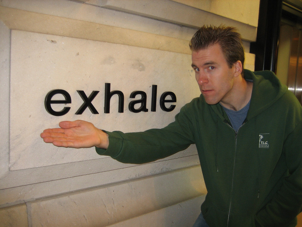 APRIL 27, 2006<br /> <br /> Exhale.  Well, we finally did.  At 1am on the 1 train uptown.  This is Jason.  You may recall him from the ACCOMPLICE CUZ gallery.  He was the one who loved our CUZ hats and stopped Lovejoy and me in Union Square.  Well, tonight we had some sushi and met for real.  He stopped by this sign when we were taking a walk after dinner and posed in true smugmug fashion.