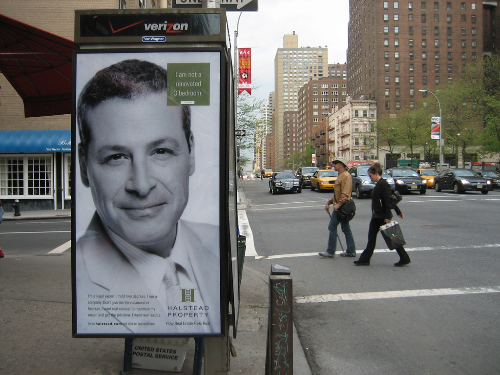 """APRIL 25, 2006<br /> <br /> You know you've lived in New York City a long time when...you are walking to your crime scene investigation class, pass by an antiquated phone booth and see a HUGE poster of the head of a guy you went out with once.<br /> <br /> So either he has given up acting for good and become a real estate agent or Halstead uses actors to promote their properties.  One thing we do know...he is """"not a renovated 3 bedroom apartment"""".  WHAT?  Look closely at the upper right hand corner in green.  Random."""