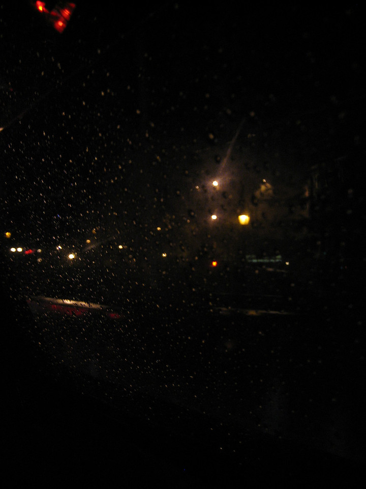 JULY 18, 2006<br /> <br /> In a cab in the rain.