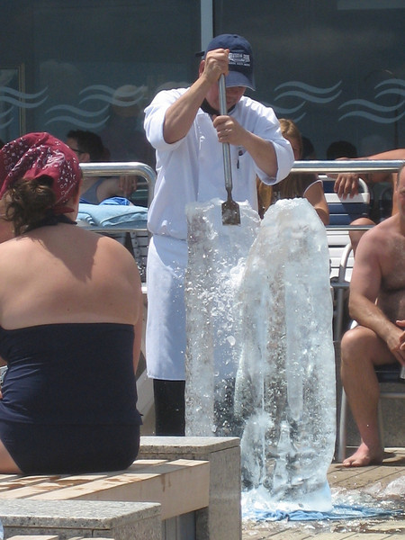 """JULY 7, 2006<br /> <br /> Friday morning we left Bermuda and had a day at sea.  It was a spectacular day.  The weather was perfect.  We sat by the pool, read, ate, watched them carve ice sculptures, ate...you get the picture.  This is Edwardo.  He is quite a talented ice sculptor.  See the rest of the shots and what he carved in the gallery, """"The Cruise""""."""