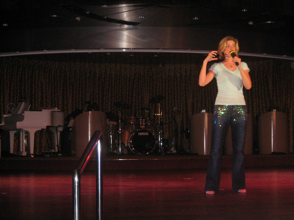 "JULY 8, 2006<br /> <br /> Our last night at sea was the ""Talent Competition"".  Jordan impressed us all by performing her standup in front of a large cruise audience.  She brought the house down.  Unfortunately she didn't win the big trophy.  Some Kenny Rogers look-a-like sang and took the prize.  However, she won our deep respect.  Kaylor loved his watching his Mom and clapped loudly after her set.  Thanks for being so brave, Jor!  You rocked."