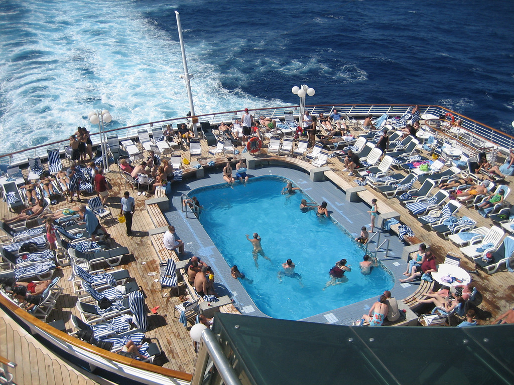 JULY 3, 2006<br /> <br /> It was between this shot and a pic of Sean playing shuffleboard on the deck.  I beat the pants off of him in that one shot, so I thought this would be more fair.  Plus, it's just so quintessential cruise.  I loved this view of the pool.
