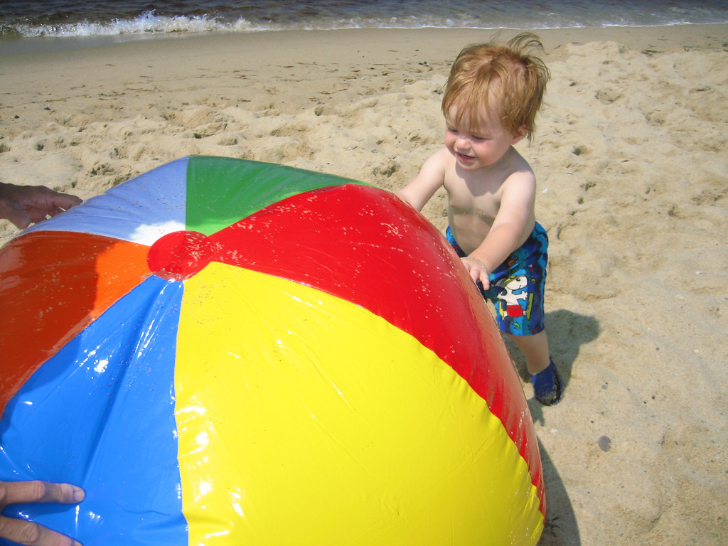JUNE 29, 2006<br /> <br /> Kaylor and beachball.  I loved that they were almost the same size.  Thanks to Grandma who blew it up!