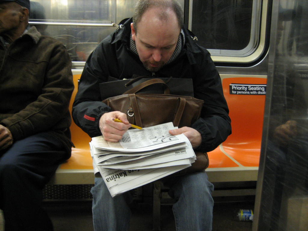 MARCH 2, 2006<br /> <br /> I loved this guy on the 1/9 train heading uptown.  He was voraciously completing a crossword puzzle and in true New Yorker style, was utterly oblivious.  He didn't even notice me taking his picture.  I do get credit for not using a flash and being VERY sly.