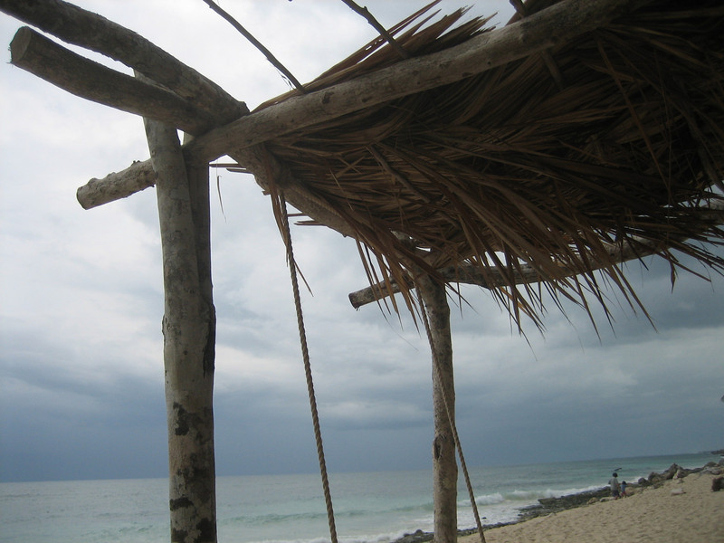 MARCH 24, 2006<br /> <br /> Lying on our hanging beach bed on the only cloudy day.  A storm approaches on the horizon.  We had lunch under the canopy of palms while it rained lightly and then passed.
