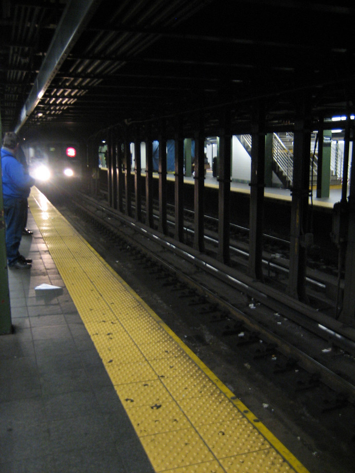 MARCH 9, 2006<br /> <br /> Waiting for the 3 train at 42nd Street.