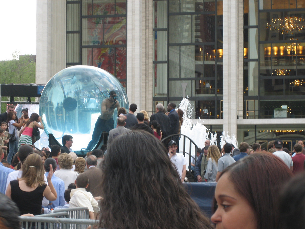 """MAY 6, 2006<br /> <br /> David Blaine being """"Drowned Alive"""".  Rita and I walked by Lincoln Center today and visited this crazy character floating in his bubble.  In typical Blaine fashion, he fasted for three days before diving into his tank.  On Monday, May 8th, after being immersed in water for a full seven days, Blaine will attempt to break the world record by holding his breath longer than any other human being.  He reminds me of a hotter Glinda the Good Witch.  <br /> <br /> Check it all out at  <a href=""""http://www.davidblaine.com"""">http://www.davidblaine.com</a>"""