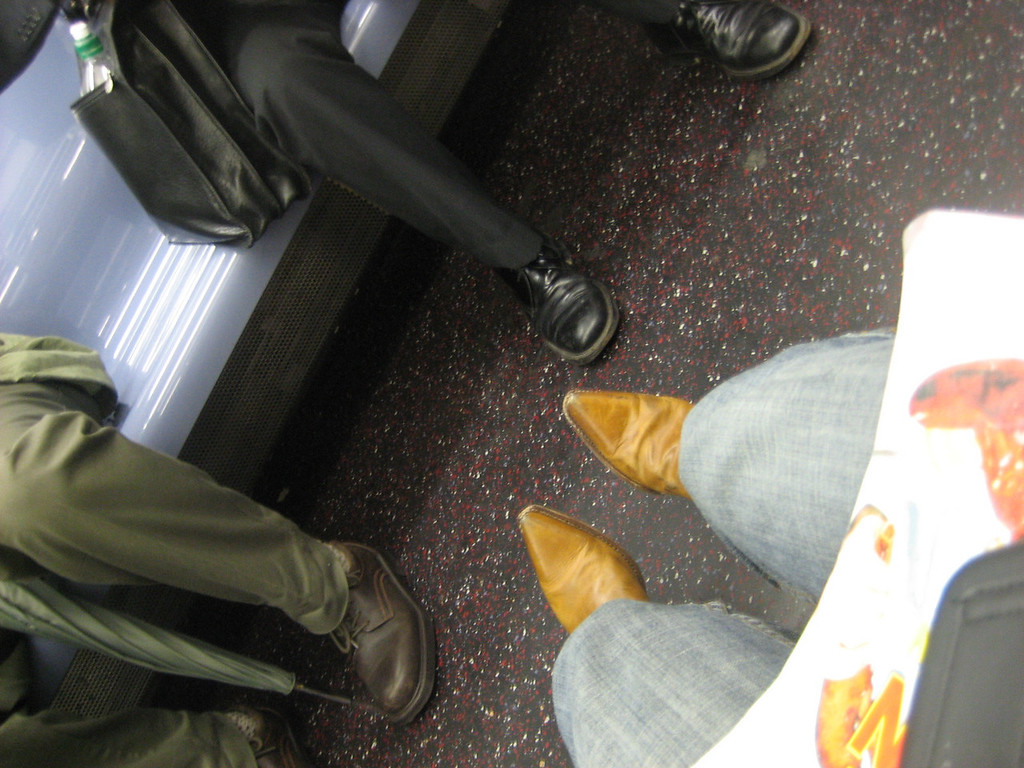 MAY 16, 2006<br /> <br /> Reading a magazine on the subway.
