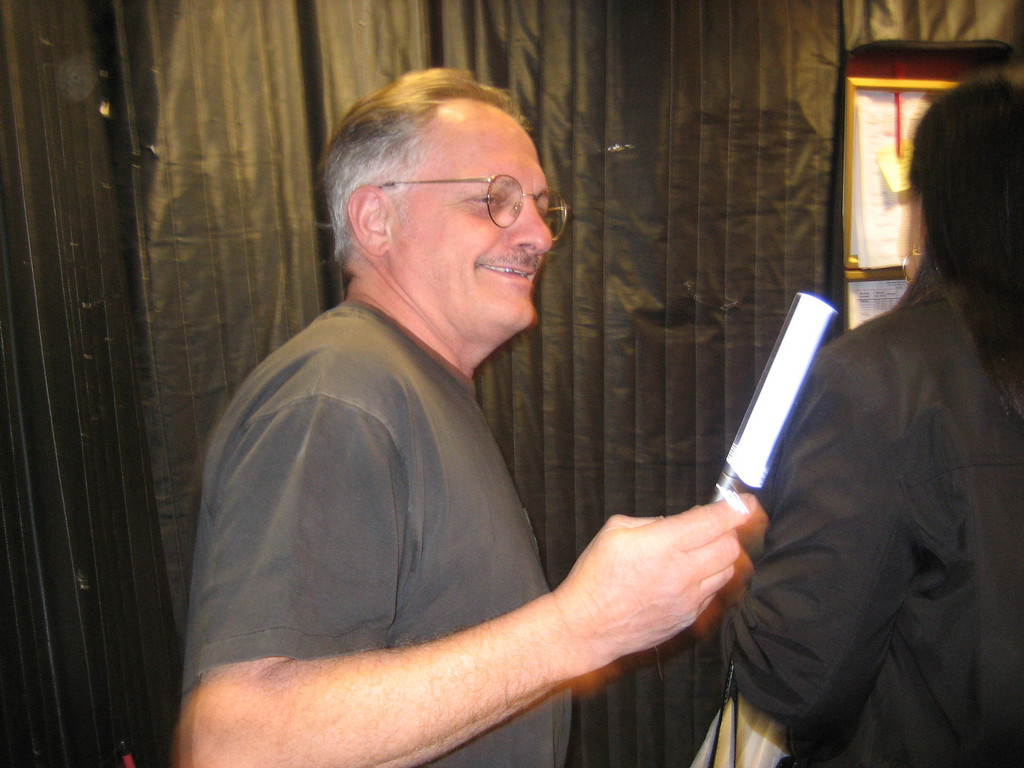 NOVEMBER 9, 2006<br /> <br /> Bumpy.  He drives the bandcar during the show and has been here at the hall forever.  Here he is in the elevator with the conductor's wand.  I think he was changing the battery.