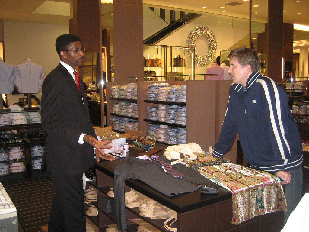 NOVEMBER 16, 2006<br /> <br /> Sean and I at Bloomies.  He had just bought a suit, me a dress...and George here was trying to sell us the perfect tie to match my dress...