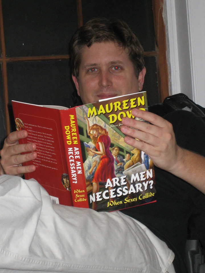 """NOVEMBER 1, 2006<br /> <br /> Sean in his office reading a book my Dad gave me last year for Christmas.  """"Are Men Necessary?""""  Come on...funny."""