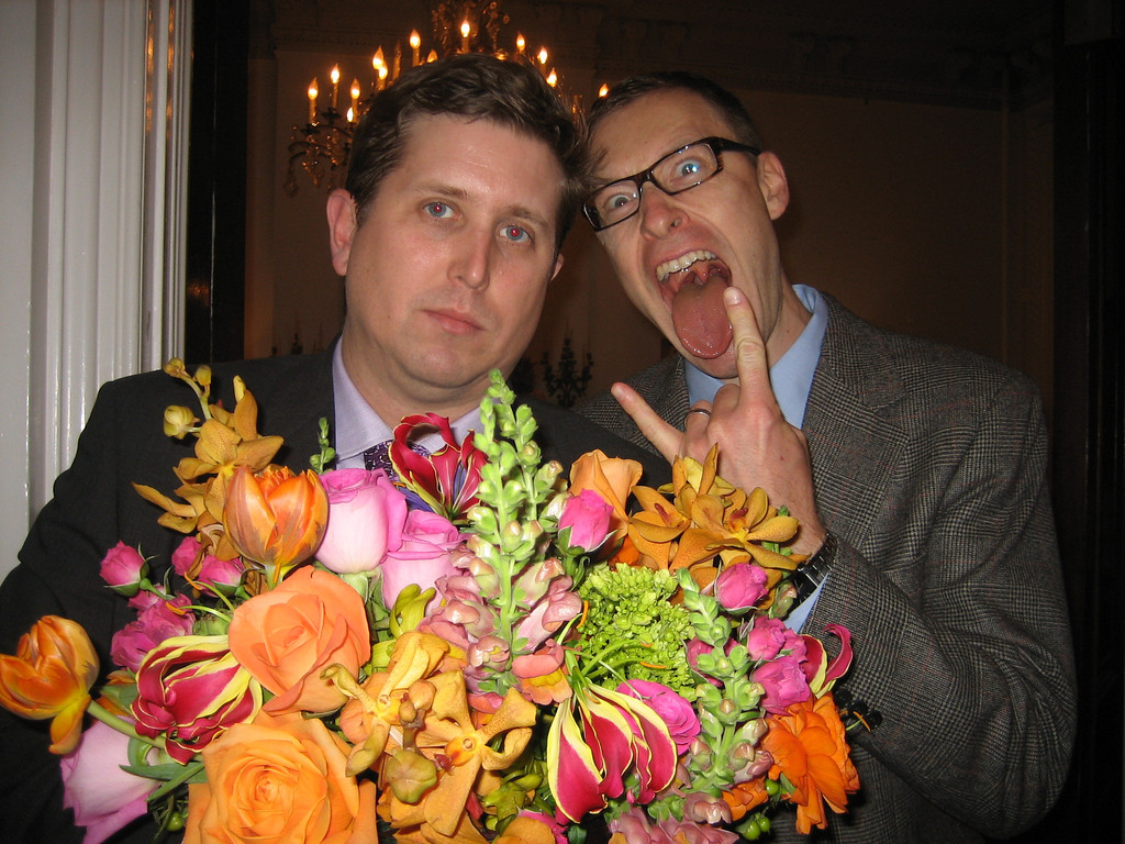 NOVEMBER 26, 2006<br /> <br /> The wedding.  Because I didn't want to take pictures at the ceremony...I didn't get a good one of the bride and groom.  This will have to do.  Sean and his friend Adam pose with centerpiece.