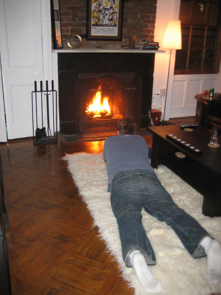 OCTOBER 8, 2006<br /> <br /> Our first fire!  I love this picture of Sean lounging on the flokati watching the fire...
