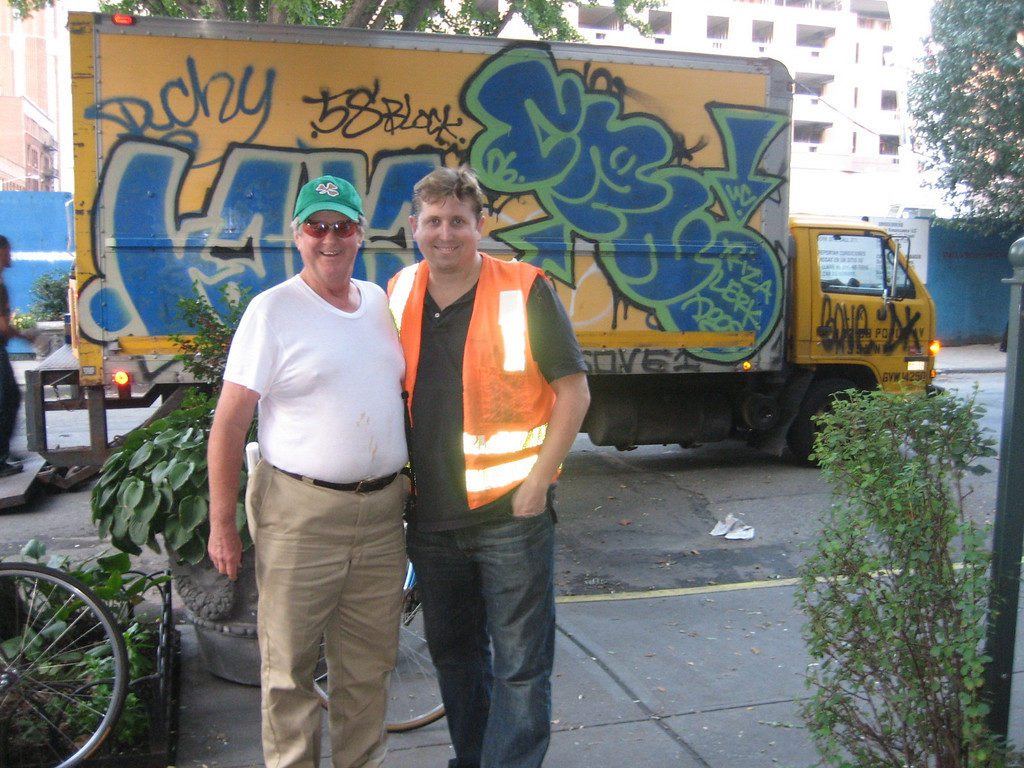 SEPTEMBER 16, 2006<br /> <br /> MOVING DAY #2!!!!  Today the same movers came and picked me us up on the upper west side and took us back to Brooklyn.  This is Nat and Sean in front of the movers' truck.  Isn't the grafitti great?<br /> <br /> Nat is our new landlord.  He's a sweetie, but is extremely into safety.  When watching the door, taking out the garbage or just walking at night, Nat likes to wear his orange safety vest.  How Sean managed to wear it for this picture, I'll never know.