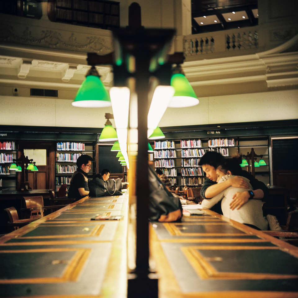 People hugging in libraries