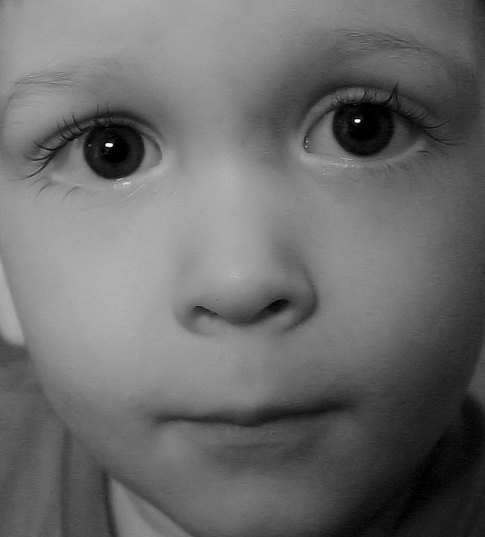 They are so photogenic--kids. And with dreamy eyes like these...what awaits him? good day full of friends, flowers and food. And to complete the alliteration it IS Friday.