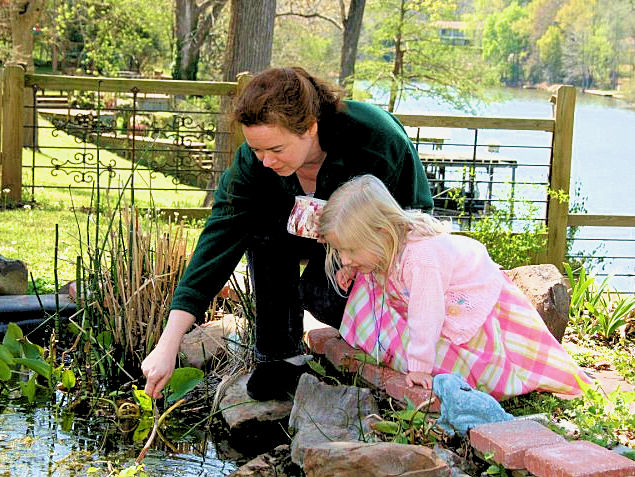 Taken on Good Friday. Me and young friend Olivia check out the pond life. Pic by her mom.