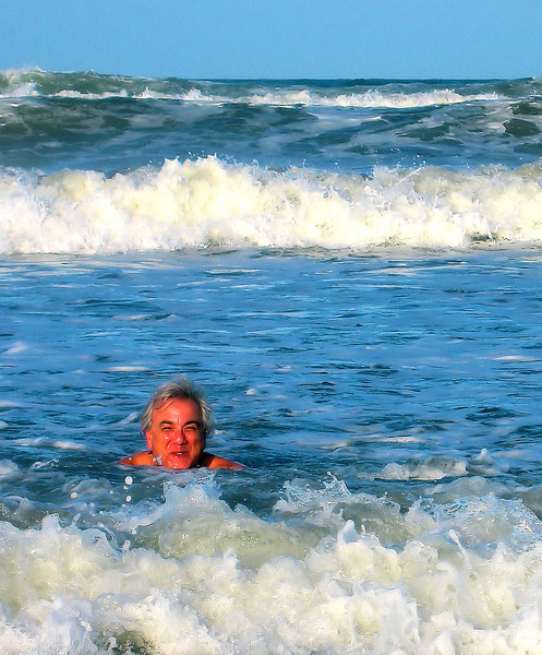Joe thinks the best way to rinse off an afternoon of cutting hair is to catch a wave.