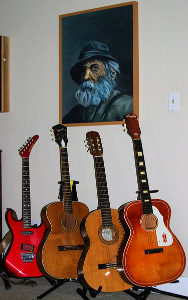 """A bouquet of guitars: tended like delicate flowers and guarded like precious jewels. They are the """"other women"""" of this marriage and I get big wifely points (evidently) for not being the jealous-type as they wrap their strings around my husband's heart."""