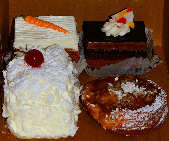 "Let the deca-dance begin!   In anticipation of tomorrow's feast, I made a quick trip to the new local bakery. I had requests for ""creamy"" and ""chocolaty"". These should hit the mark (if they make it 'till then....hmmm)."