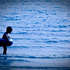 """""""Blue ocean"""" - 17 May. Mika hesitating a little before trying out the ocean"""