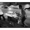 """Up the hill"" - Mon 28 July<br /> <br /> Spent the evening taking pictures outside, finding things that represent the city that never sleeps...and where food is available at all times.<br /> <br /> These guys were pushing their food carts up a bridge that crosses a small ""klong"" (or canal). It looked better in B&W and I added noise to give it the feel of old ISO 1600 film<br /> <br /> (tomorrow night off to China, so expect some China pictures coming week...)"