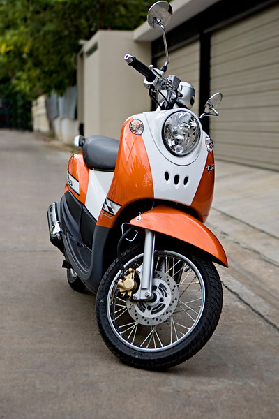 """""""Fino"""" - Sun 7 Sep<br /> <br /> Bought a Yamaha Fino today! 125cc, fully automatic, retro look and 800 euro... what more can you ask for? <br /> <br /> Now only need to figure out how to drive it in the Bangkok traffic...ha ha ha - Helmet on!!!<br /> <br /> Tomorrow evening off to Singapore"""