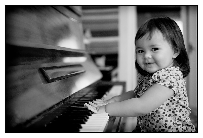"""Thu 26 Aug - The Pianist<br /> <br /> Today on the road again. To Katrineholm and Oerjans new summerhouse and then visit to dad on the way back home. Dad has a piano that Mika liked to play when he was small (-er), and seems Isabella enjoys it too... (although the use of fingers seems a little bit limited, more """"whole hand"""" approach..)"""
