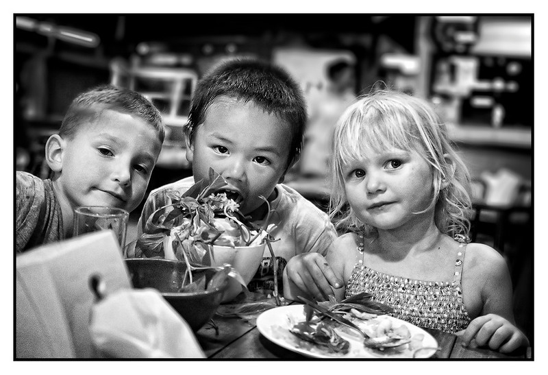 """Fri 5 Feb - Friends<br /> <br /> Back in Bangkok to meet friends Robert/Annika with kids Lucas and Olivia, and my former colleague Goeran, all staying at our place. Dinner at the local thai place around the corner, and kids enjoying making a """"take whatever is available on the table"""" salad"""