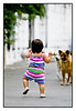 Sun 14 March - Walking<br /> <br /> Isabella training her walking skills outside, and the two neighborhood dogs keep an close eye on the progress. Tonight to a sports bar to watch F1 premier with Helder, yeah : )