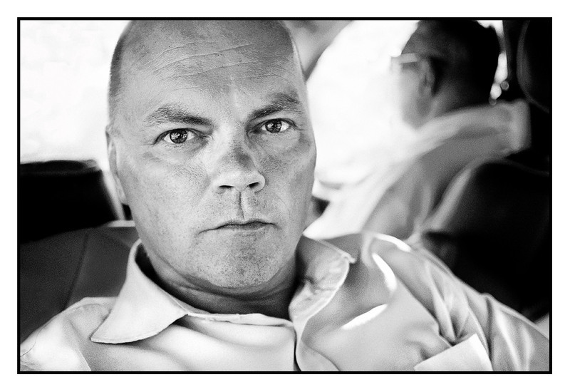 """Wed 3 March - Me<br /> <br /> Bought contact lenses again for the first time in many many years, so thought it's time for a self portrait (not many pictures of me while I'm behind the camera...)<br /> <br /> Here on my way back from office and Sam is driving. Normally take """"business class"""" home, and that means i turn the seat backwards, which gives a lot of leg space. This is also the only good thing about the KIA car..."""