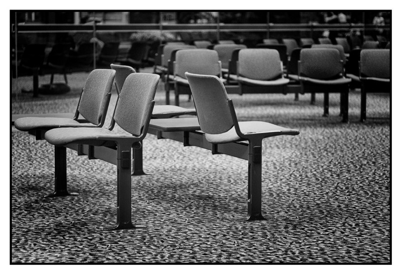 Wed 26 May - Empty chair<br /> <br /> Quick in and out to Singapore today for customer visit (big order coming). Flight back to Bangkok half full only as people still nervous about the situation.<br /> <br /> Me and Sam had to race home to make it before curfew went in place 24.00. Sam sent me and then by motorbike home, and just made it  5 min to midnight (don't know how serious if you get caught out, but colleagues said you risk a month in jail and a hefty fine if caught out during curfew hours)