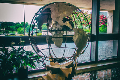 I haven't taken many pictures inside the place I work and I very little time left to get some. Here is a globe that is at the side entrance of the building. Very 70's