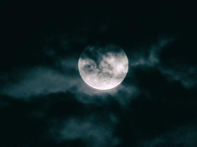 A cloudy Waxing Gibbous moon