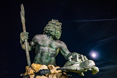 Neptune statue has the moon for backup