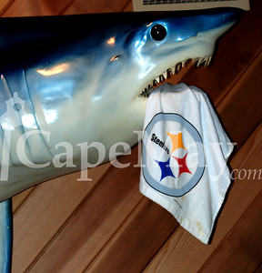 The well-known shark above the Pilot House bar is a Steelers fan!