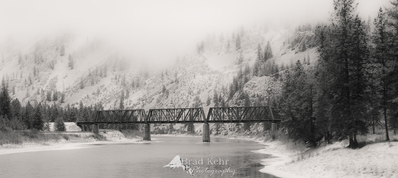 A Bridge Over the River - Winter - Montana.<br /> <br /> Thank you all for the comments on this photo and the others over the past few days. Though it is not my intention to use this forum to sell, all of my Pictures of the Day are available for purchase.